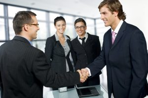 Businesspeople shaking hands in a modern office